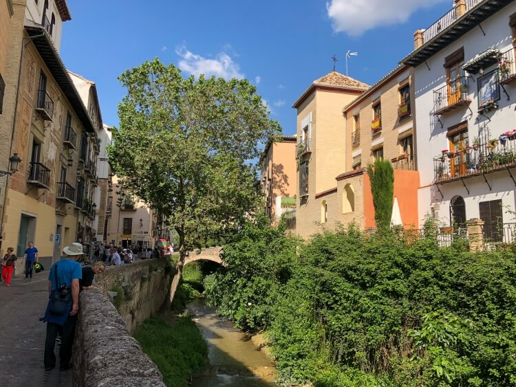 Carrera Del Darro view with alleyway, river and bridge