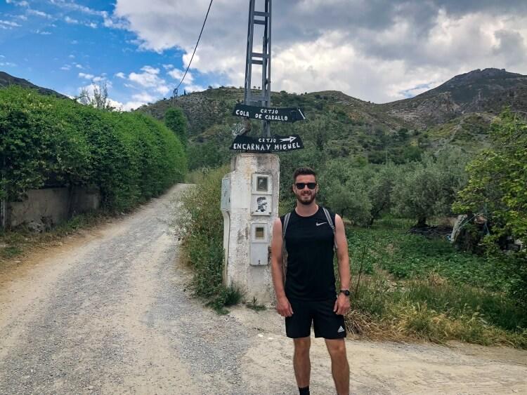Mark on los cahorros hiking trail in Sierra Nevada