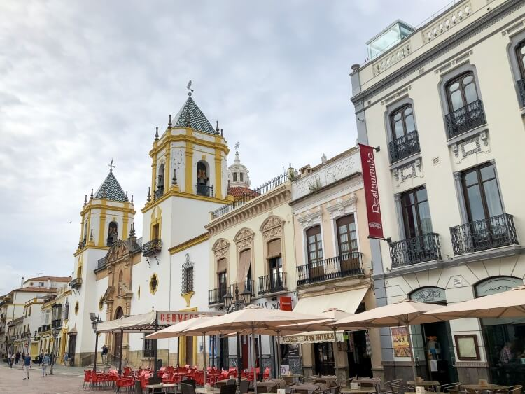 Plaza Mayor in Ronda with restaurants and a cathedral