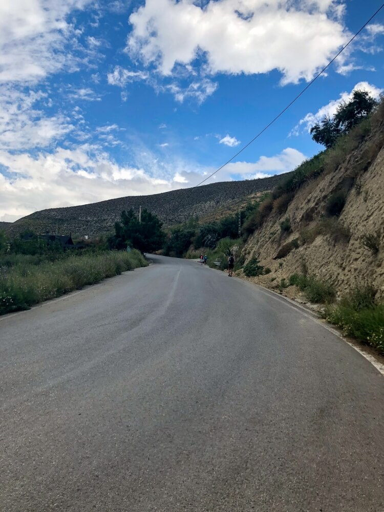 hairpin in roadway marking the start of the trail