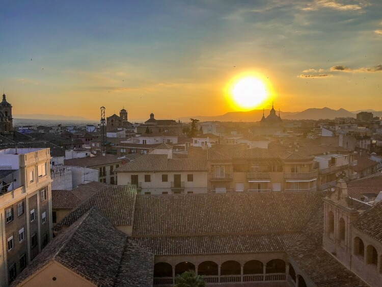 sunset over granada from pension window
