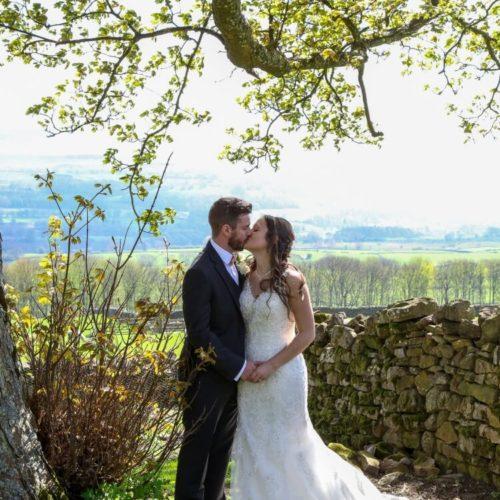 Mark and Kristen wedding photo under tree