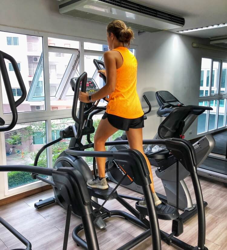 Kristen working out on elliptical travel fitness
