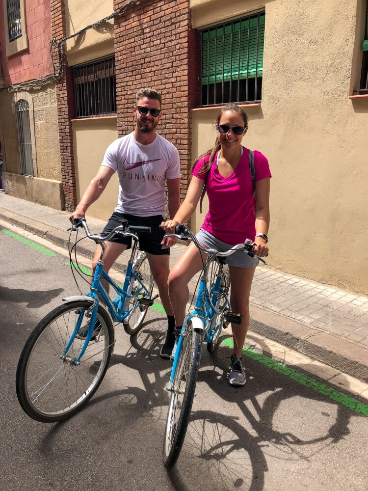 Mark and Kristen biking during a weekend in Barcelona