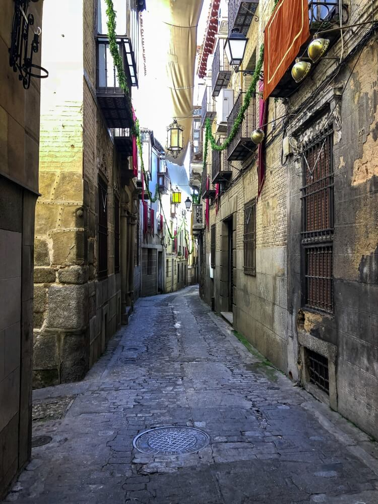 Walking through the narrow streets on a day trip to Toledo