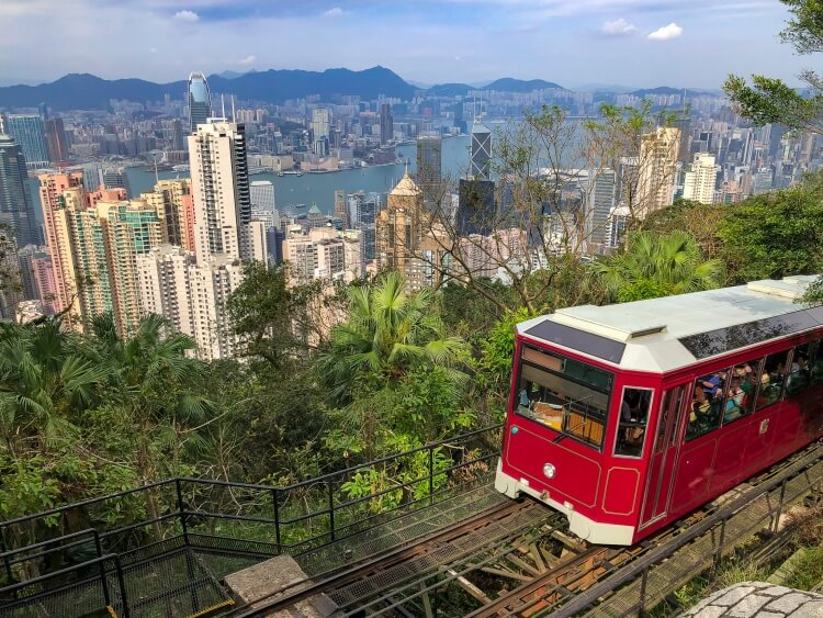 The red tram with Victoria peak in the background