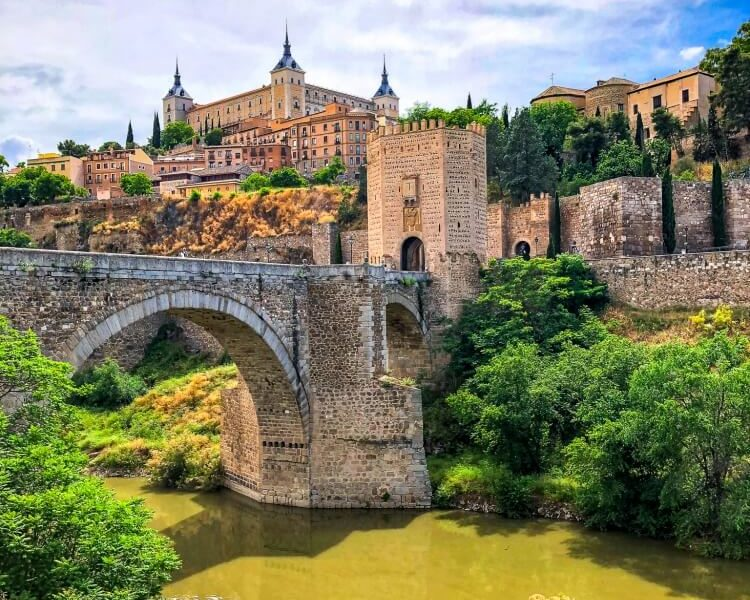 Main view of the river, bridge and Alcazar on a day trip to Toledo