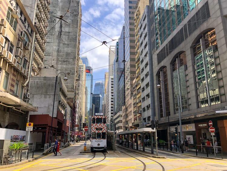 a metro in between several buildings