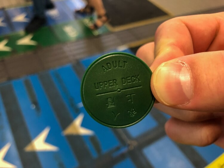 A coin allowing entry on the star ferry as something to do in Hong Kong