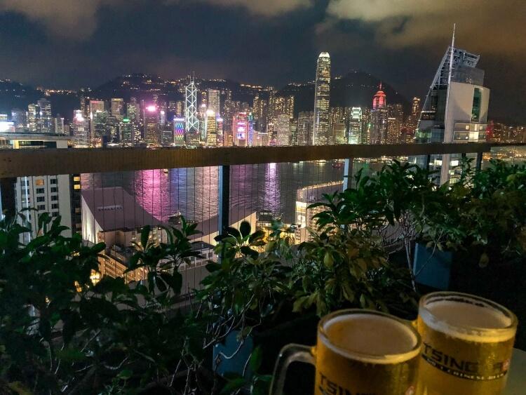 lights reflecting into the water over Hong Kong