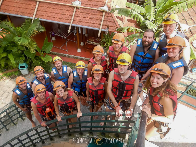 Entire tour group on spiral staircase before zip lining to cave entrance