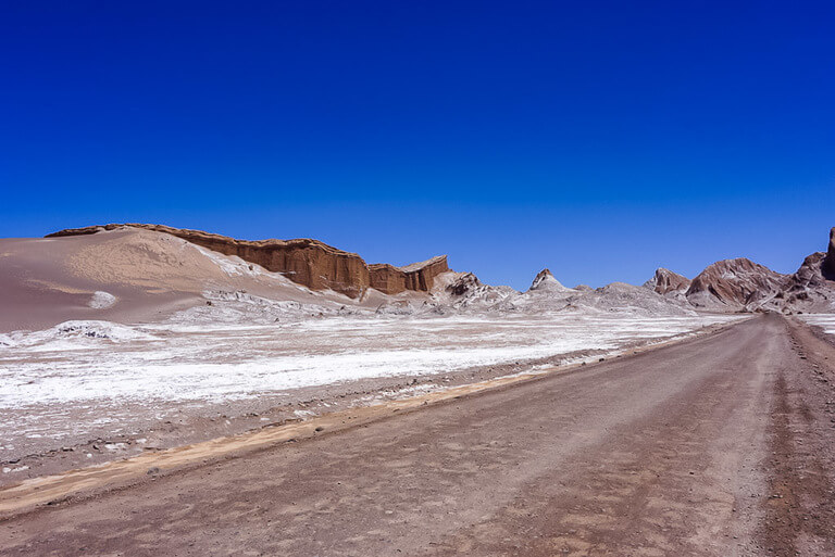 road leading through valle de la luna amphitheater