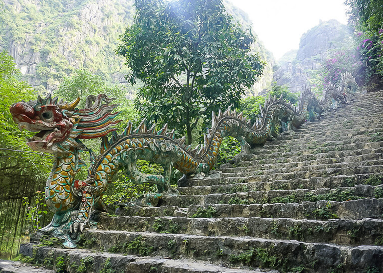 colorful dragon staircase rail along side of stone steps