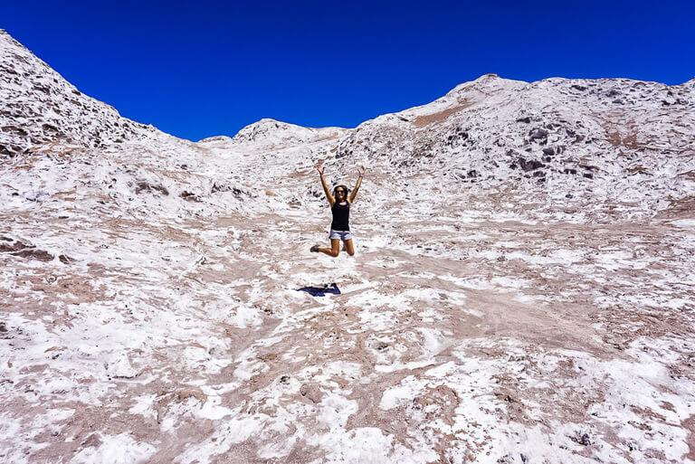 kristen jumping for joy on very salty rocks in valle de la luna