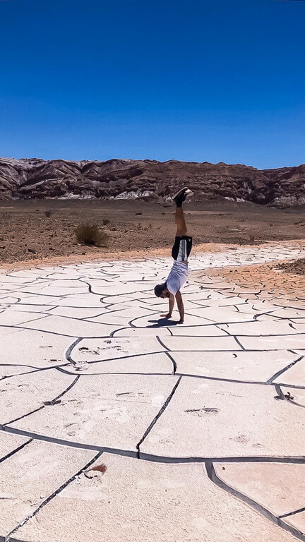 mark trying a handstand on cracked salt mud in atacama