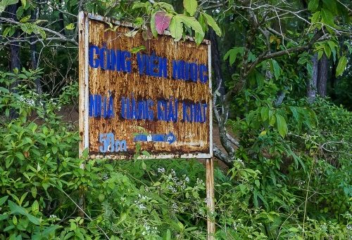 badly rusted old sign in water park hue