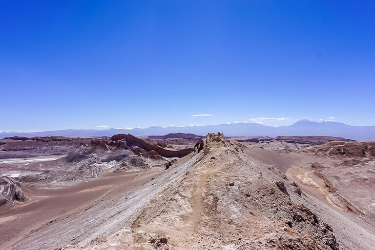 jagged moon like rocks and view over valley in atacama