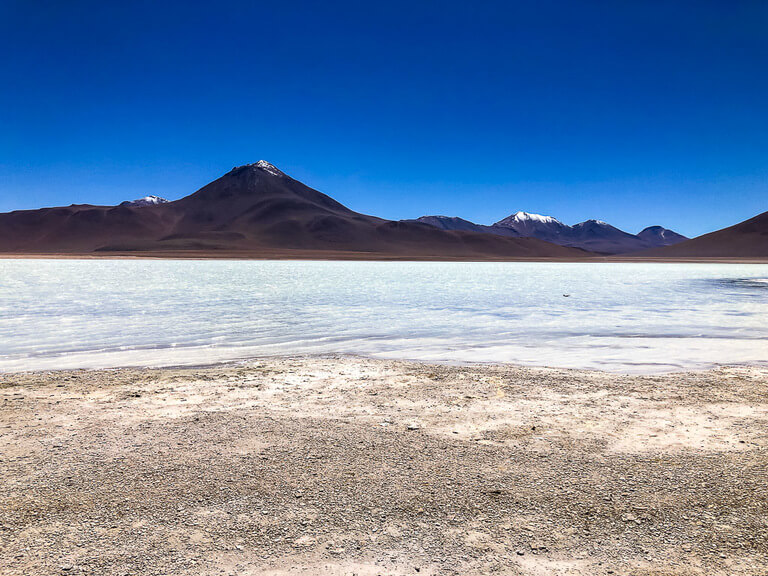 salt flat and volcano on San Pedro de atacama itinerary