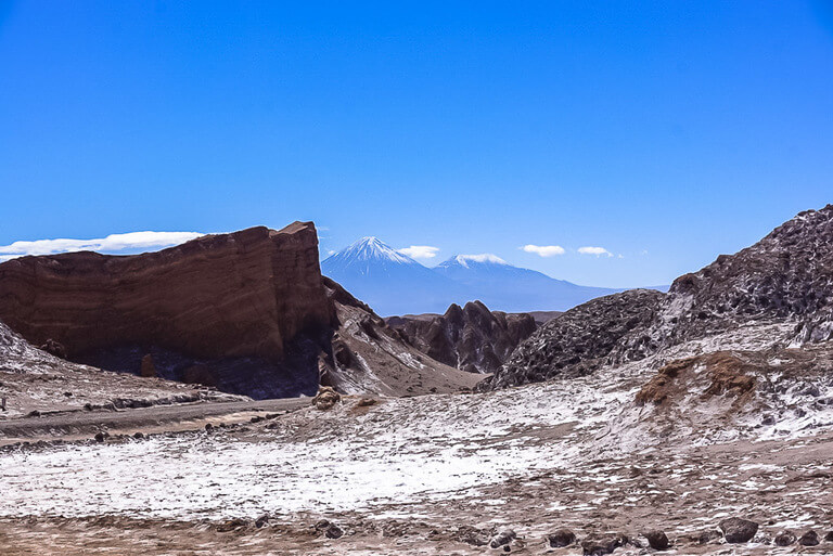 high salt concentration on rocks with volcano in background valle de la luna
