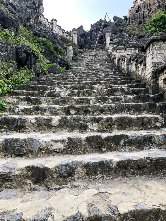 old stone staircase leading up to Mua Cave viewpoint Ninh Binh
