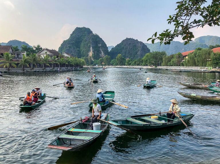 Tam Coc boat tour on Ninh Binh itinerary boats leaving dock