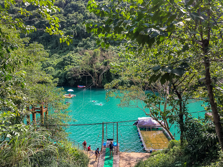 obstacle course over the bright turquoise river at dark cave