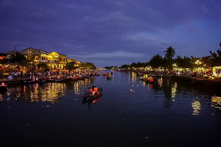 Boats on river Hoi An itinerary at night banks lit up