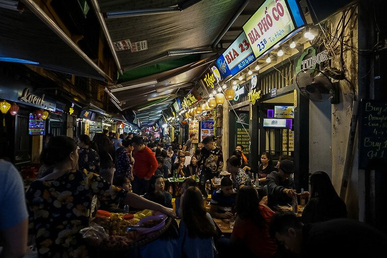 Ta Hien beer street in hanoi crowded with tourists drinking beers