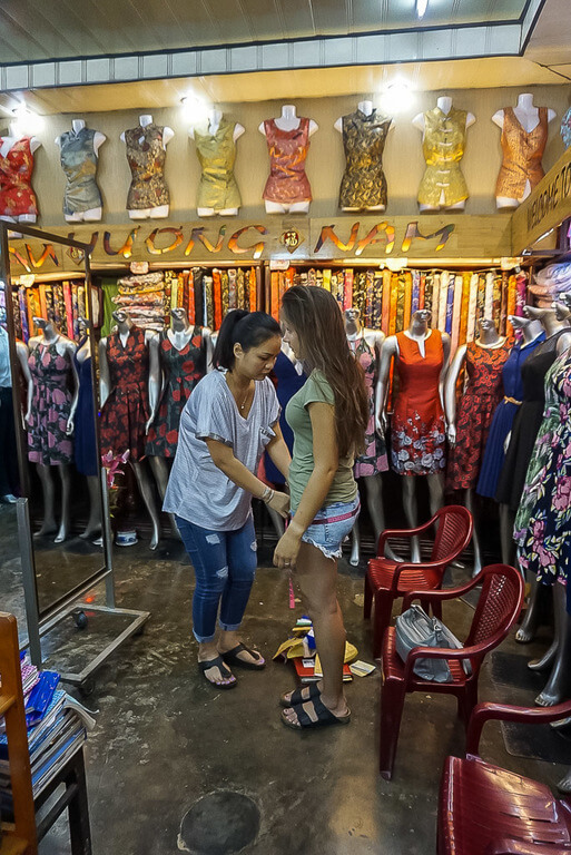 Hoi an itinerary kristen having dress fitting in tailor