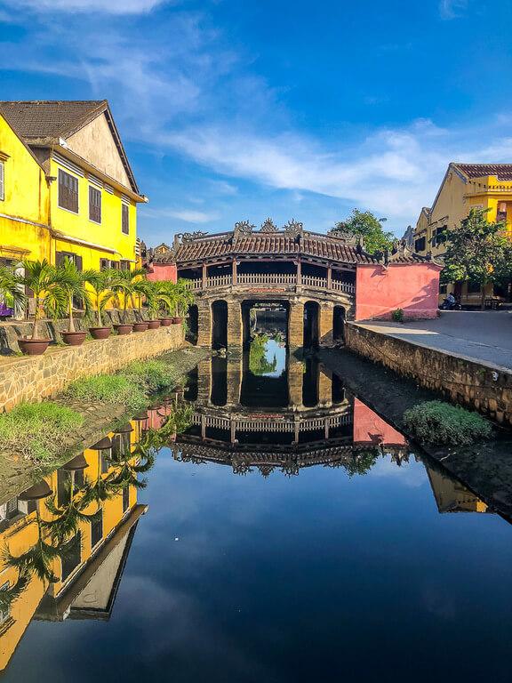 Stunning Japanese bridge reflecting off water in Hoi An itinerary vietnam