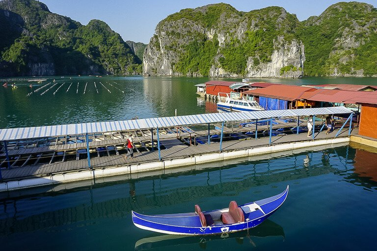 Fishing pontoon and kayak in rocks