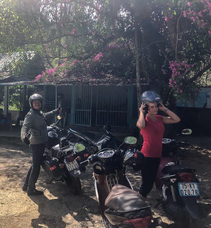 Dr Phu and Kristen stood next to their motorbikes in Vietnam
