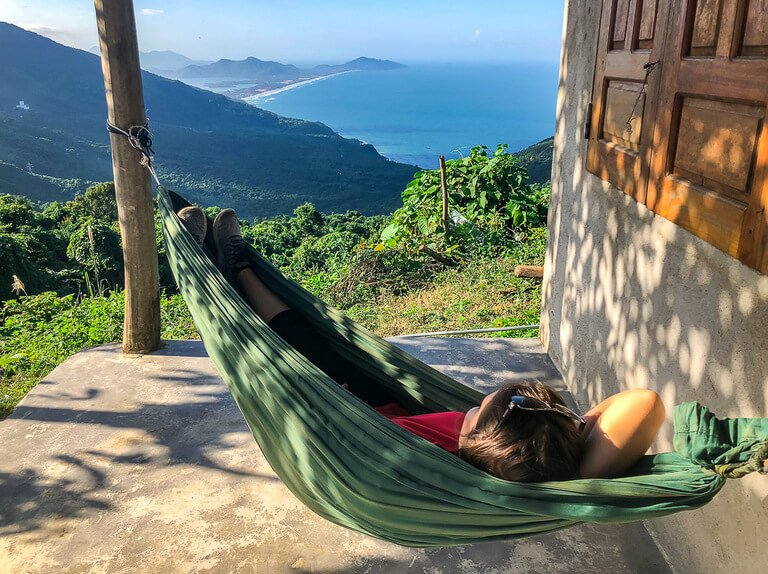 Kristen relaxing in a green hammock with amazing view between hue and Hoi An Vietnam