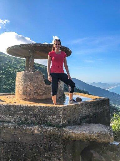 Kristen stood on bunker at top of Hai Van Pass Vietnam