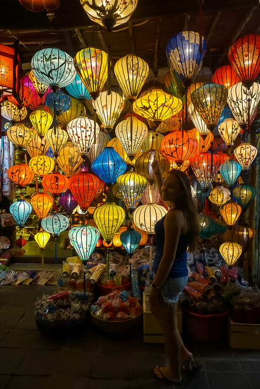 Kristen in front of colorful lanterns Hoi An itinerary vietnam