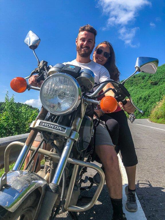 Mark and Kristen on guides motorbike on hai van pass