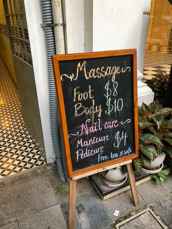 Massage parlor blackboard sign with prices