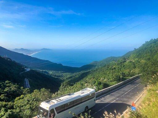 Tourist bus on scenic hai van pass route