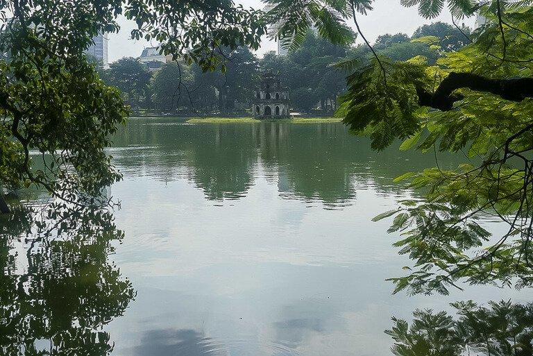 Hoan Kiem lake and turtle tower in Hanoi Vietnam