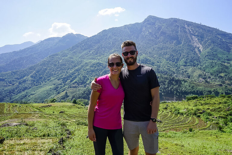 Mark and Kristen enjoying the sun on rice paddies trekking sapa vietnam