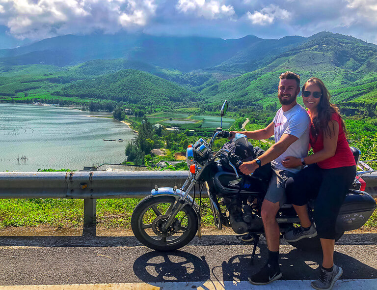 Mark and kristen on a motorbike crossing Hai Van pass near da nang on way to Hoi An