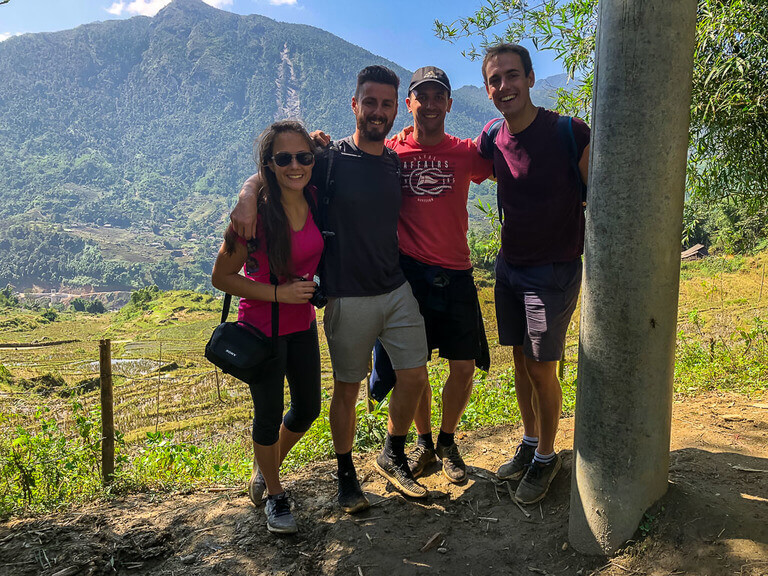 Mark Kristen and two Spanish men smiling in a group in sapa vietnam trekking