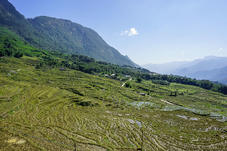 open view of green valley on mountain side trekking in sapa vietnam