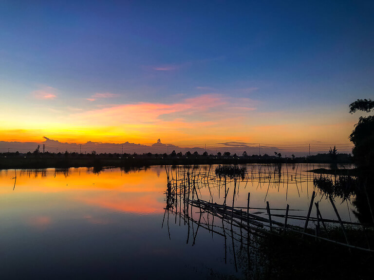 Gorgeous colors in sky sunset in Hoi An vietnam over river