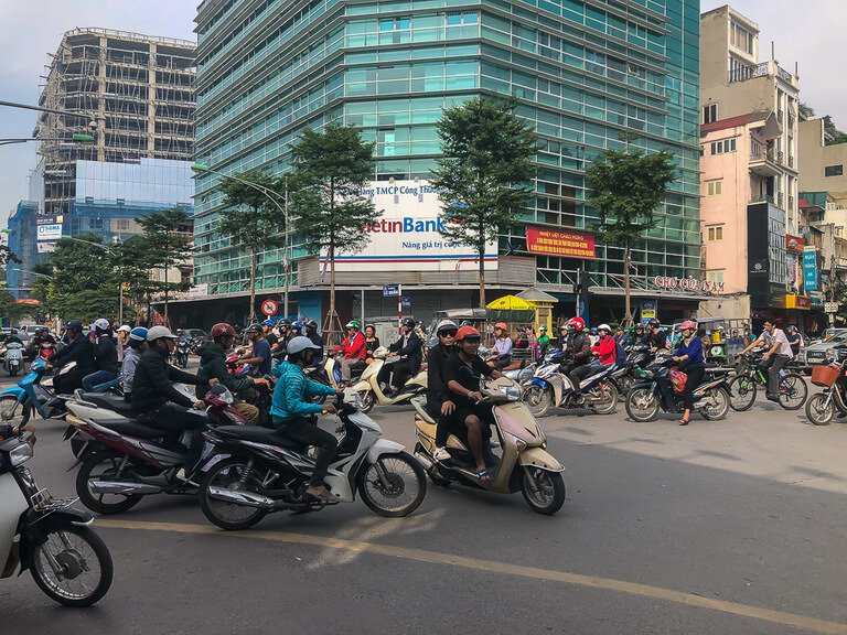 hundreds of motorbikes crossing roads at once 2 days in hanoi is enough