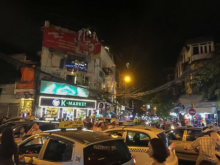 cars and motorbikes trying to cross same roads in hanoi 2 days its enough