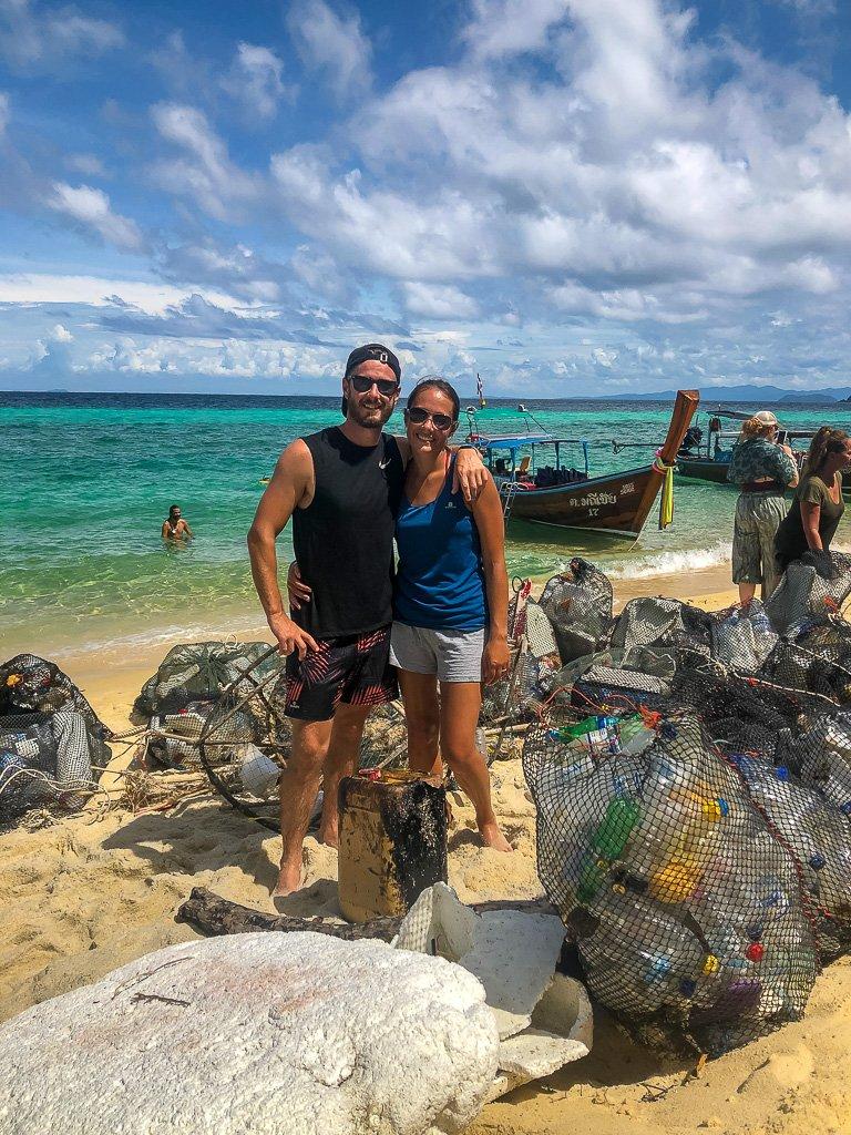 Mark and kristen clearing up plastic bottles in Koh lipe thailand