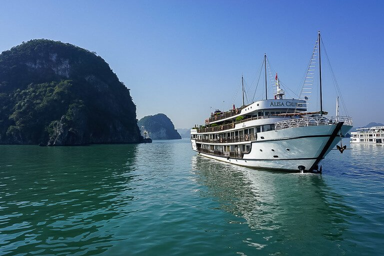 Cruise ship on turquoise water in Halong bay