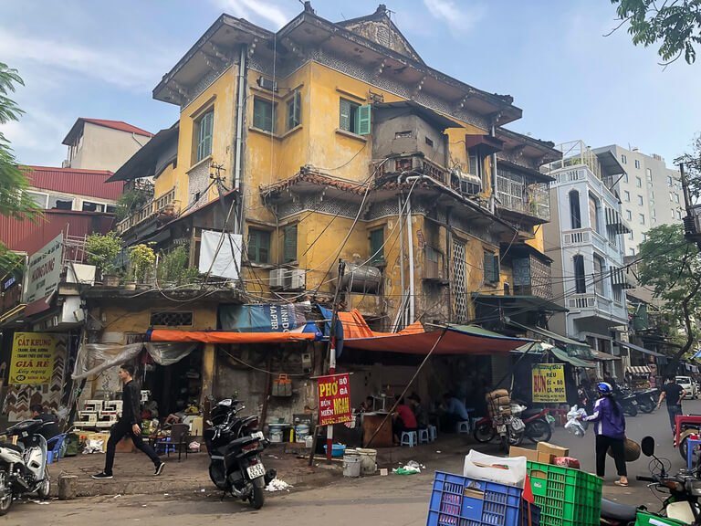 why 2 days is enough in Hanoi rundown buildings and junk scattered