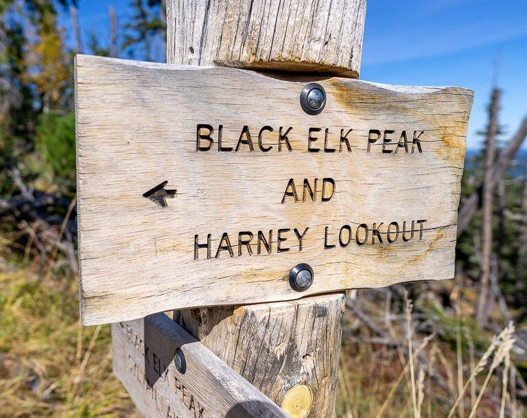 Wooden sign black elk peak hike and Harney lookout